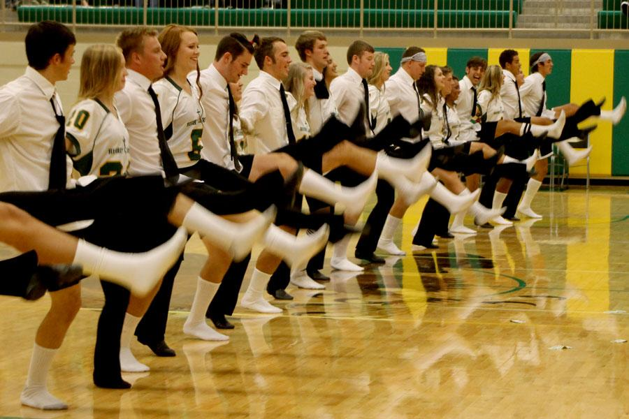 Senior Football, Cross Country, and Soccer boys show off their high kicks with the BC Pommers. Photo by Lydia Crownover