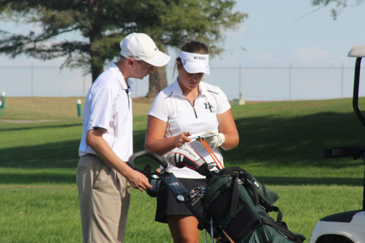 Abby Sauber talks to her coach, Mark Berger.  Photo by Katie Gross