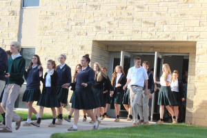 Students evacuate the school during the drill.