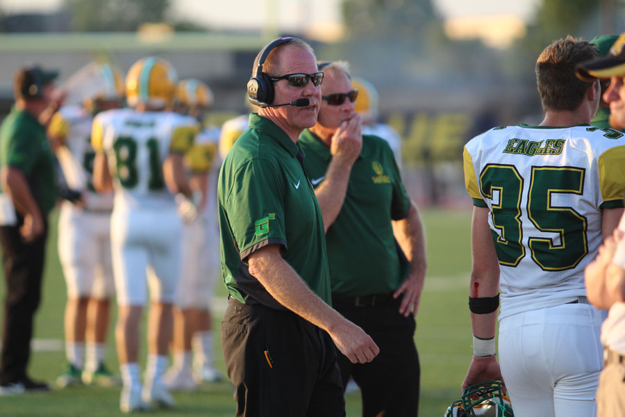 Coaches Trail and Blanton Strategizing during the Northwest Game