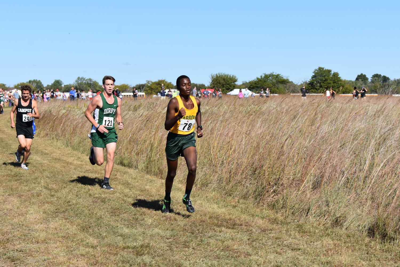 Junior Eric Nganga races in the cross country meet at El Dorado on Saturday.