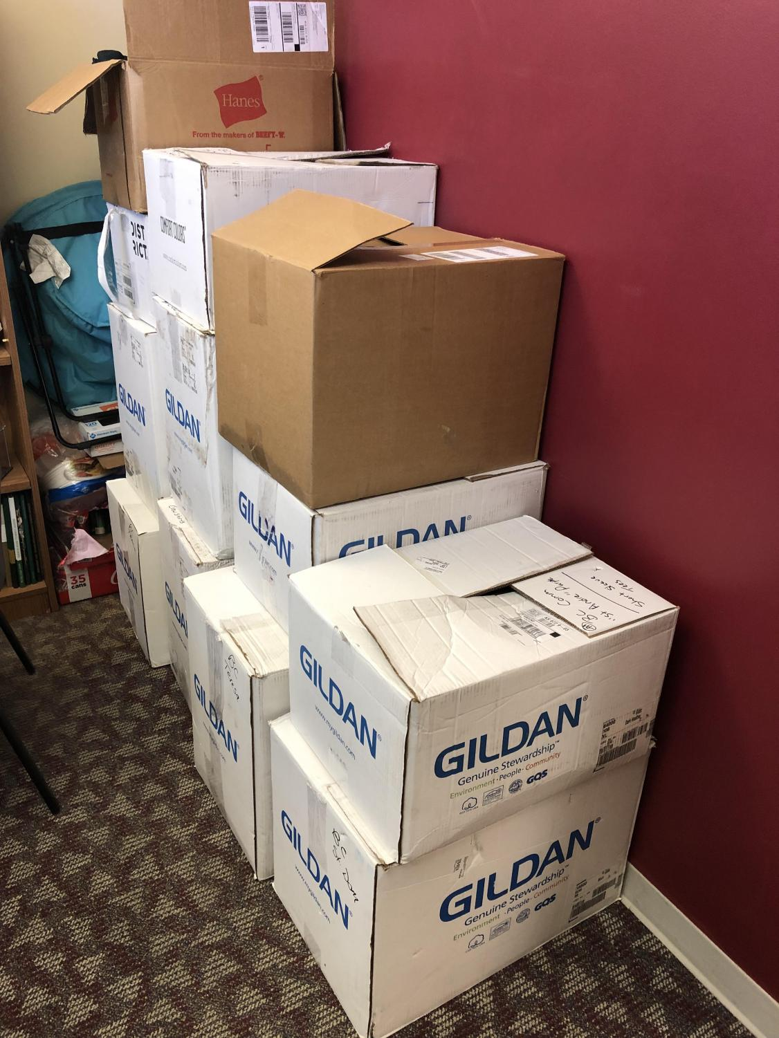 All these boxes crowding up Alan Schuckman's office are just 3 communities worth of t-shirts.