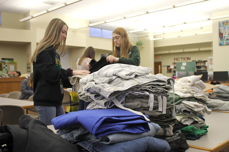 Students folded and sorted clothes Thursday morning. Photo by Joseph Winter.