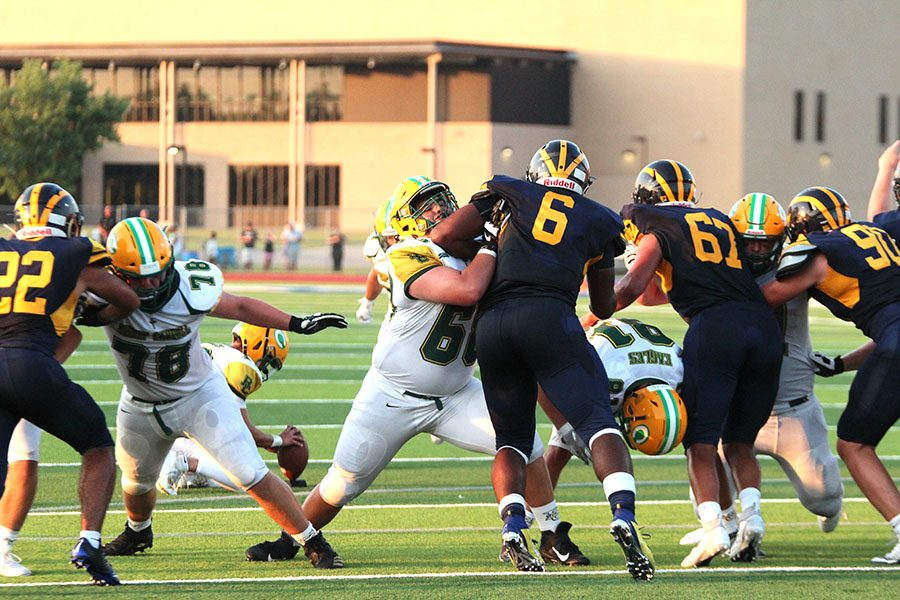Linemen+battle+in+the+NW+game.+Photo+by+Reagan+Smith.+