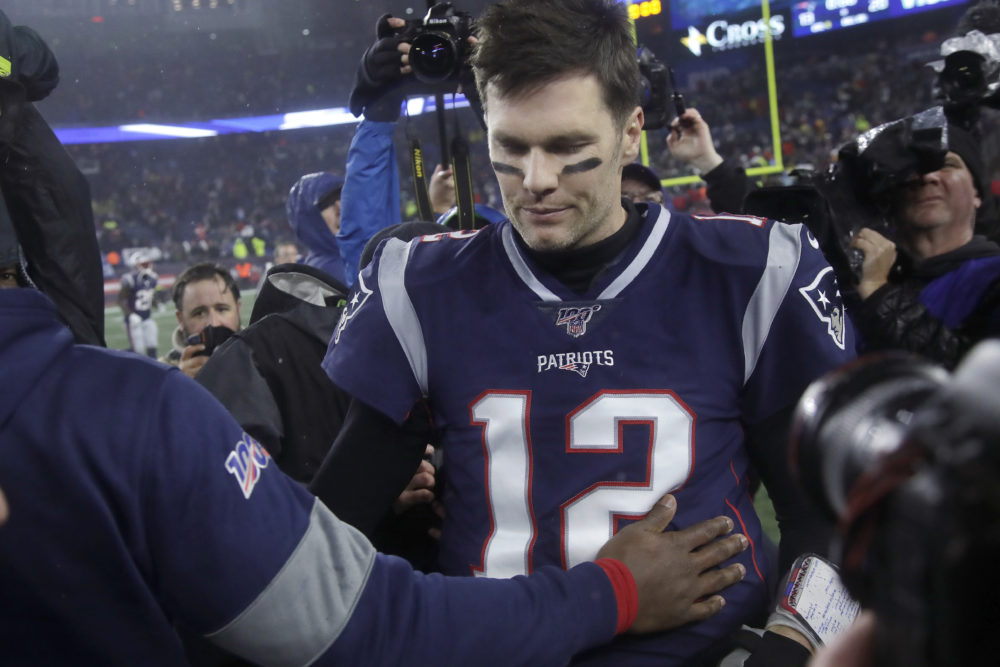 Long time Patriot quarterback Tom Brady leaves the field at Gillette stadium in what could be his final game as a New England Patriot