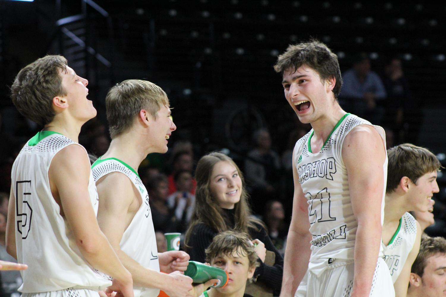Star Guard Tanner Mans celebrates with his teammates after a huge win earlier in the season