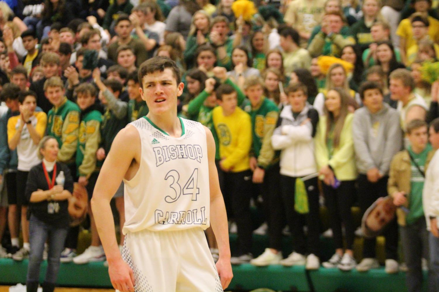 Carroll Junior Forward, Enrique Lankford, hypes up the home crowd in the teams last matchup against the Crusaders