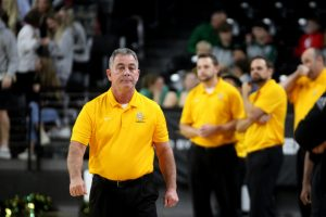 Coach Domnick pacing up and down the court during the teams matchup against Andover Central earlier in the season
