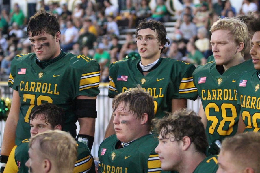 Players watch the action during the Dodge City victory. Photo by Aubrey Schnieders.